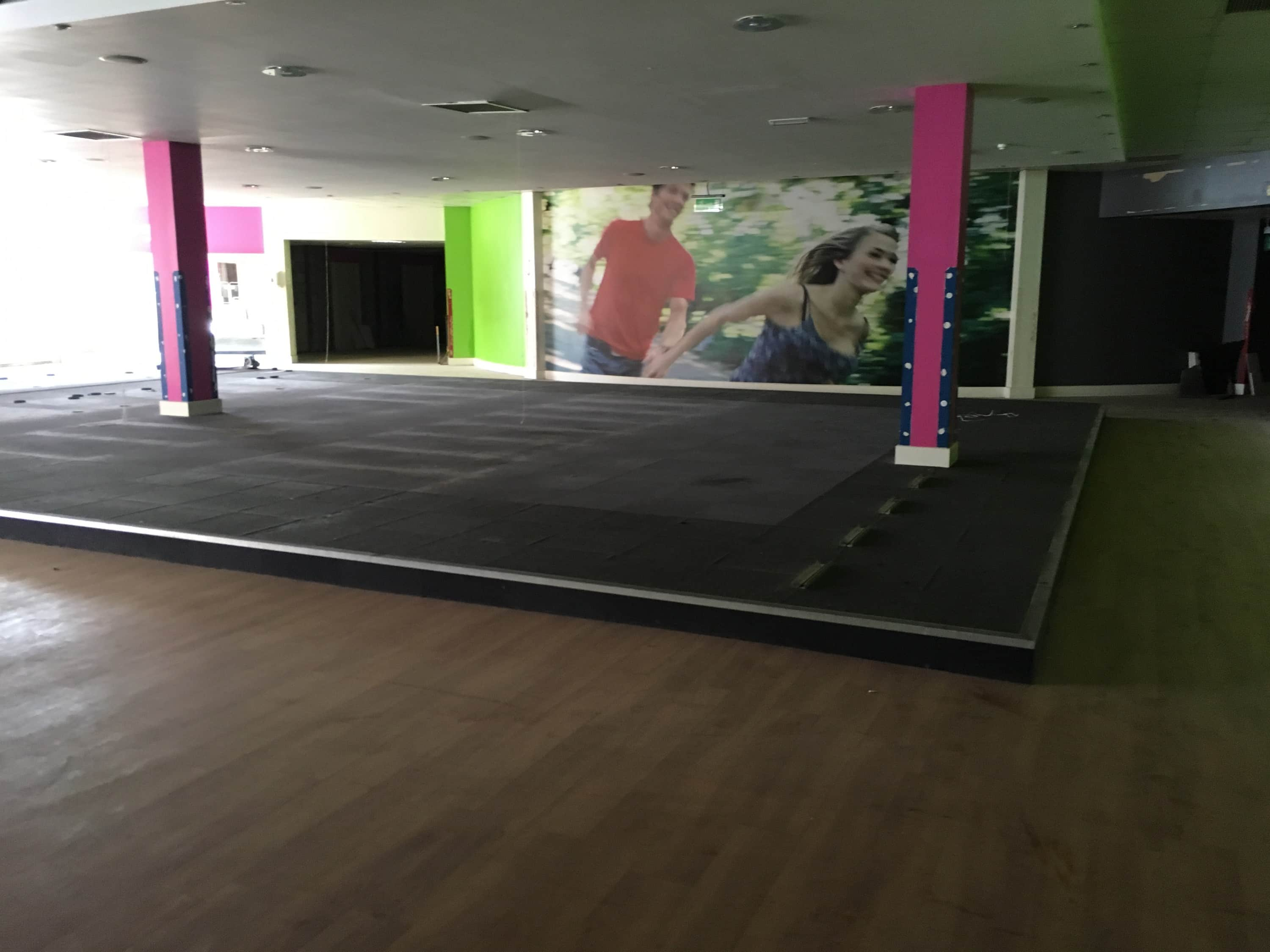 An image of the site before the fit out, depicting an empty former gym in a leisure complex in Milton Keynes