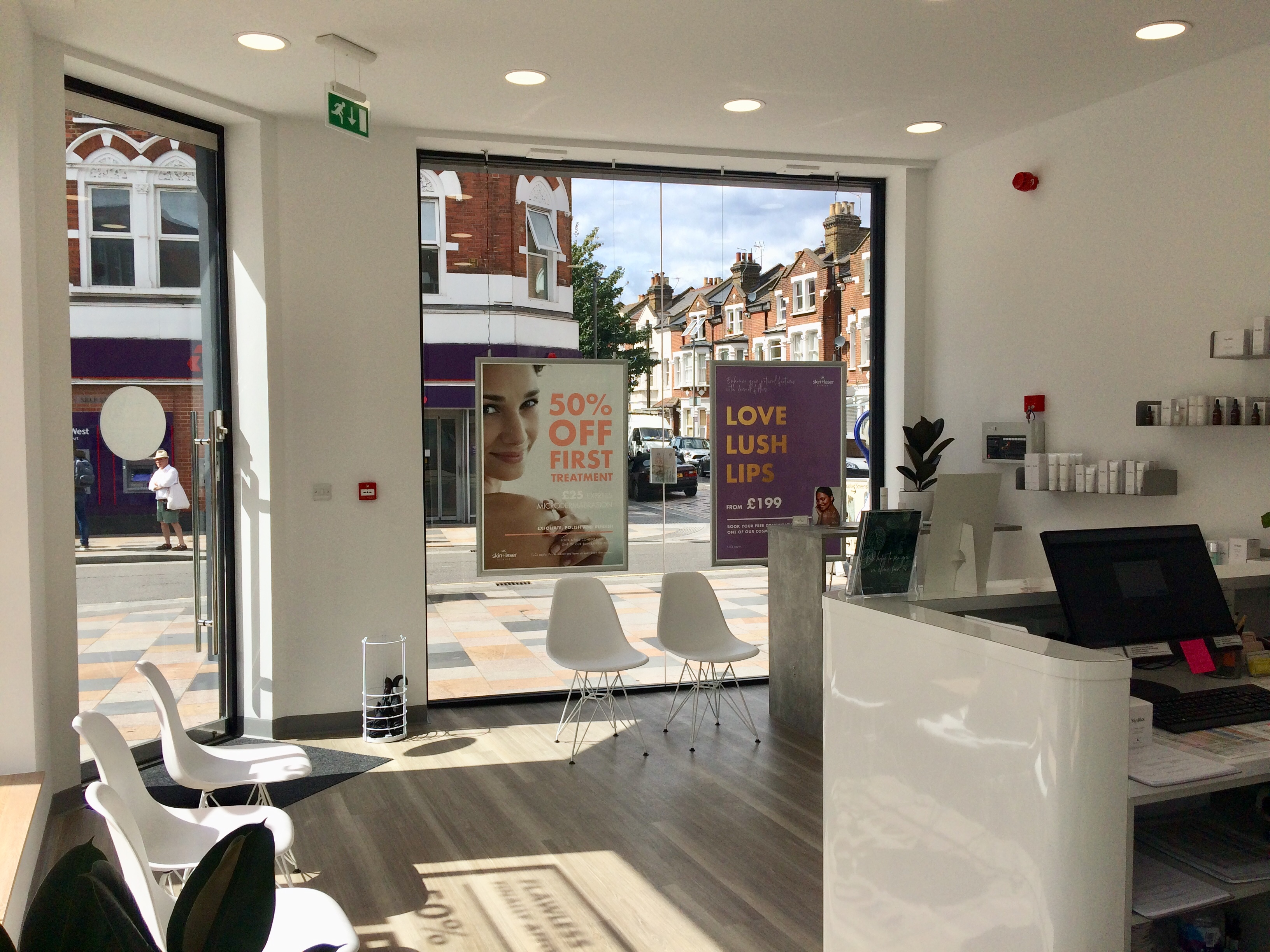 Image of the inside reception area looking out onto the street of UK Skin and Laser clinic in Clapham